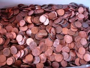 Monedas de 1 y 5 céntimos de USA al peso